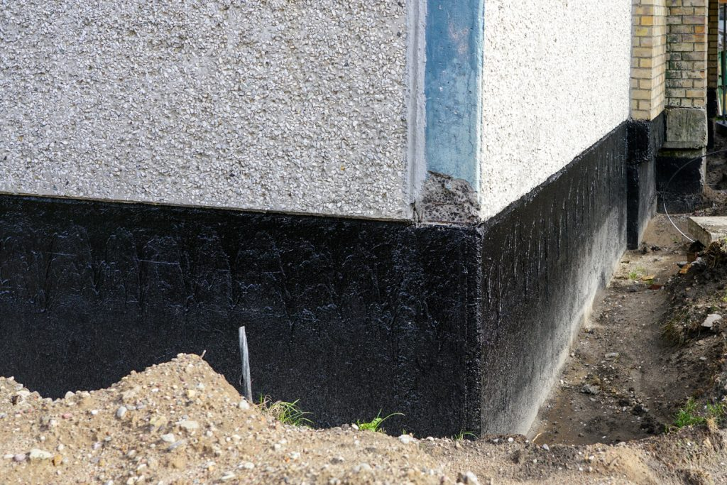 house foundation waterproofing and damp proofing with bitumen membrane